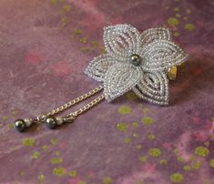 Swaying pearl drops dangle from a star like transparent crystal flower. The flower is 2 inches wide. The whole piece is 3.25 inches in length. The flowers are attached to a hardware of your choice. (pictured here with alligator clip) This piece is graceful and exotic, and was inspired by the beautiful kanzashi (hair ornaments) worn by geisha and maiko. If you like this, be sure to check out my kanzashi collection! ^_^ ____________________________________________________ All my b...