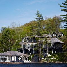 A cozy seaside home was designed with a neutral base infused with nautical hues by Muskoka Living Interiors on Lake Rosseau, Port Carlin, Ontario, Canada.