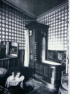 Bathroom in London, 1895. This bathtub probably folds up like a Murphy Bed. : )