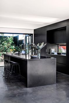 "In the kitchen, the concrete bench and flooring merge with [Polytec](http://www.polytec.com.au/?utm_campaign=supplier/|target=""_blank"") joinery in Black Natura. **Bar stools** from [Cult](http://www.cultdesign.com.au/?utm_campaign=supplier/