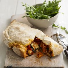 Italians enjoy these folded, baked pizzas as a street food similar to Cornish pasties. This version is packed with roasted Mediterranean vegetables, melting mozzarella and crumbled goats cheese.