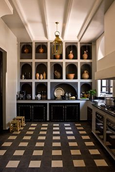 Black white - that is a lovely accent wall except for the studded cabinet doors