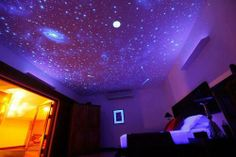Use glow-in-the-dark paint/ white or neon paint and a black light to create a star/ space/ galaxy mural.