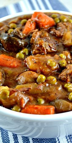 Easy Crockpot Beef Stew. The gravy is thick and rich and deliciously beefy. It's loaded with lots of mushrooms, potatoes, carrots, peas and great herbs! This is one of my familys favorite Crockpot meals.