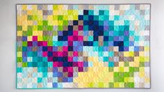 Ashley Nickels shares a simple, modern approach to designing your own pixelated jelly roll quilt top, with lots of time-saving tricks built into the process. You will learn how to lay out your quilt on a design wall, and then chain-piece the squares without having to pin or clip. Best of all,...