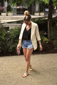Transitioning cut off jean shorts from day to night with a white blazer and bodysuit. (Via Confessions of a Product Junkie blog.)