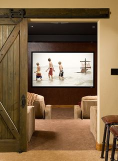 Timber Frame Theater I like idea of sliding barn door for access to master suite