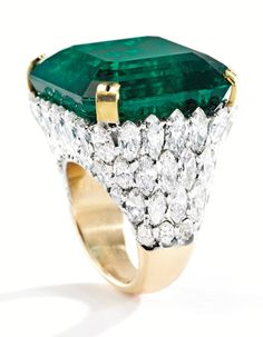 Magnificent platinum and 18K gold ring centering a square emerald-cut emerald weighing 61.35 carats, within a mounting accented by marquise and pear-shaped diamonds weighing approximately 17.00 carats was sold for $4.6 million at Sotheby's on Wednesday Dec 11.