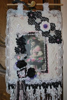 Fabric lace wallhanging with black, white and touches of pink and purple. DT project for Melscraftboutique