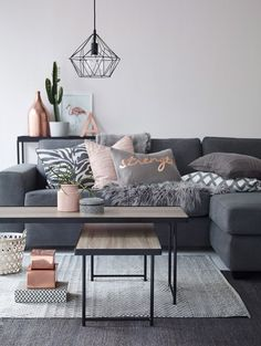 Modern living room in grey with copper and pink accents. Geometric diamond pendant lamp.