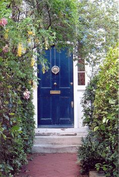 I just adore a front door where the knob is in the center.  I don't know why.  Probably because I have to do everything that no one else does.