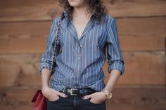 dainty necklaces over a buttondown