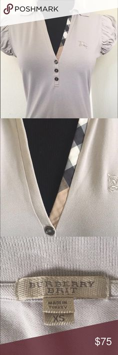 Burberry Brit Xs polo Made in turkey Authentic Burberry Brit XS tan woman's polo in Mint condition Burberry Tops Button Down Shirts