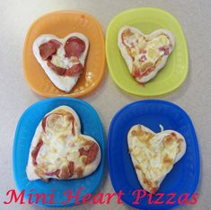 Mini heart-shaped pizzas make a fun Valentine's Day dinner, and are even more fun when the kids get to create their own!  This fun meal and activity was also very frugal.