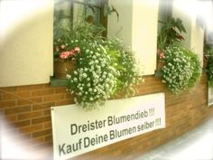 "Flowerboxes are a popular way in Germany to 'green up' the curb appeal. In this case they were so pretty that they kept disaappearing ... Photo: ehp for www.GoRaRa.com Nachricht an den bösen Buben: ""Kauf Deine Blumen selber!"" Foto: ehp für www.GoRaRa.com."