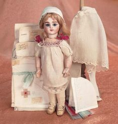 Two Different Worlds: 175 Petite French Bisque Bebe Bru with Chemise and Costume Elements