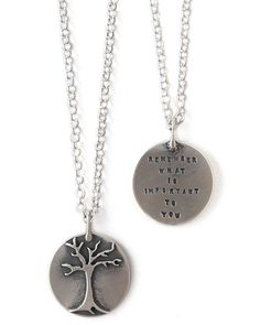 """Remember what is important to you."" Artist Kathy Bransfield pairs a single tree on a sterling silver circle with the soul-searching saying on the back. The simplicity of the pendant will make it even more special and thought provoking to the wearer, and it will be a constant reminder to always keep your life in perspective."