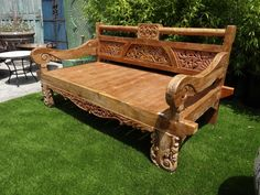 """Balinese Carved Teak Daybed @flea_pop Balinese carved teak daybed. Intricate carved wood daybed with detail across the back and legs. Carving of a Ganesha in the middle of the back rest. Thick teak wood frame and seat. Perfect for inside or outside in the garden. Finished in a light brown lacquer. Unique! dimensions: 78""""L x 44""""W x 39""""H"""