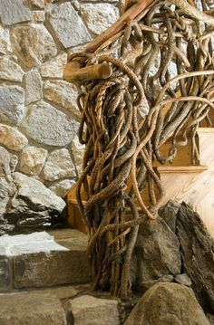 Stair railing made from vines, twigs and branches. Description from uk.pinterest.com. I searched for this on bing.com/images