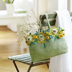a flowery crochet shopping bag