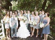 @Christine Christus - is this what you were looking for? Men are wearing vests, bride is in lace and mis-matched bridesmaid dresses. I like the grey for september.