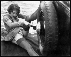 There are a lot of sexy images of women in the 20's fixing cars. I guess it was a fetish thing. Flappers are women who can change their hubcaps.