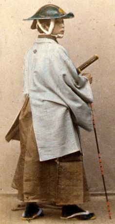 japanese officer in gala costume samurai wearing a jingasa and holding a muchi