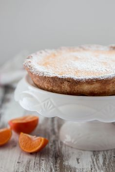 A fresh tangerine tart with subtle hints of ginger and cardamom in the smooth and creamy filling.