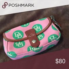 Dooney & Bourke Wristlet Like new Dooney & Bourke Wristlet! Used once looks brand new! Paid over $125! Check out my closet too Dooney & Bourke Bags Clutches & Wristlets