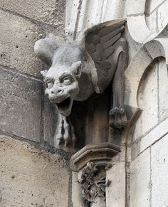Notre Dame. Why they put a Monster (Gargouille) on the church ????