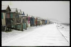 beach huts in the snow, saw this and immediately knew it was whitstable!