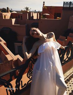 Dressed in white, Jacquelyn Jablonski wears Alexis Mabille sleeveless dress and Louis Vuitton trousers