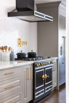 Mud Colored Cabinets Light Gray Warm Black And Br French Range White Herringbone Porcelain Backsplash Pot Filler