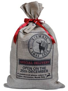 Hessian Christmas sack, reindeer silhouette stocking with red ribbon tie and gift tag on Etsy, $26.56 AUD
