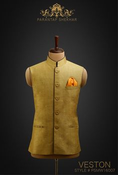 MENSWEAR:Worn Olive Yellow Hand-Spun Linen-Silk Veston, Eyelet fabric Snap Crafted Buttons at Straight front Placket.  Complete Outfit: Veston & Silk Pocket Square  For more info, catch us on  www.parantapshekhar.com