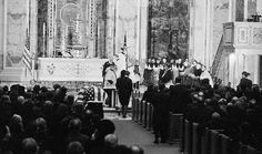 11/25/63: The Kennedy family takes communion at JFK's funeral, in St. Matthew's Cathedral.