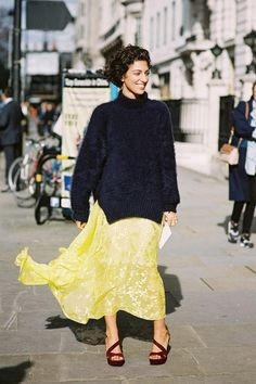 Style Tip: Toss your favorite fuzzy sweater over a flowy floor-length dress for a romantic ensemble. // Yasmine Sewell