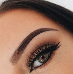 Bold brows + wispy lashes.