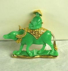 Hattie Carnegie Green Plastic Oriental Man on Steer Pin  Just $250 marked 50% OFF for our New Years Sale at Judys Gems on rubylane.com.