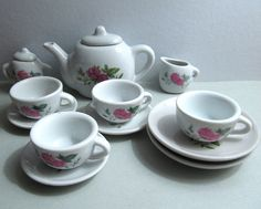 Vintage 1970's Toy tea set white porcelain.  This looks very much the same as the one I had.