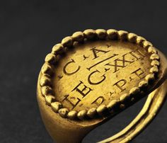 A Roman gold finger ring belonging to an armourer in the XXII nd Legion (ENGRAVED IN RING), ca. 3rd century A.D.