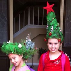 Crazy hair day! Each year our school has crazy hair day during spirit week in October. There is always the challenge to kick it up a notch!   Savannah's Christmas tree is several stacked solo cups, battery operated Christmas lights, sparkle pipe cleaners with small ornaments attached and of course colored hair spray! Mckenna's is an actual Christmas wreath with her hair wrapped around it then decorated and painted.