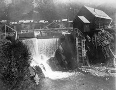 Waterfall in town of Crystal, Gunnison Co. Colo.  1893  View of the Crystal Mill powerhouse built in 1893, on Crystal River; shows the wooden dam with raised water level and the wooden shaft that turns the waterwheel; rooftops of the wood frame structures of Crystal City, Colorado in the distance.  Western History and Genealogy Dept., Denver Public Library,