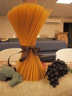 Pasta Centerpiece-Helpful TIP:make sure you glue down on round cardboard base to keep steady.Grapes from Dollar Tree Italian Table Decorations, Italian Centerpieces, Decoration Buffet, Dinner Party Decorations, Dinner Themes, Pizzeria Trattoria, Bistro Decor, Italian Themed Parties, Italian Bistro