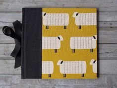 IONA BINDING - • Handmade photo album that measures 10,43 x 9,60.  • The covers are made with 0,09 book board covered with Japanese fabric printed with she
