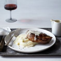 Milk-Braised Pork Chops with Mashed Potatoes and Gravy - Braising pork in milk, a method that results in supertender meat and an incredibly rich and flavorful gravy. http://www.foodandwine.com/recipes/milk-braised-pork-chops-with-mashed-potatoes-and-gravy