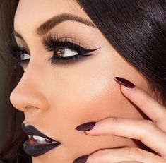 smokey dark double winged liner makeup look with dark vampy lip