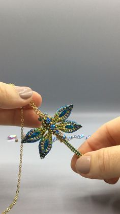 I just finished my beaded dragonfly pendant . Beading pattern coming soon! Beaded Dragonfly, Dragonfly Jewelry, Seed Bead Jewelry, Dragonfly Pendant, Beaded Flowers Patterns, Beaded Jewelry Patterns, Bead Patterns, Knitting Patterns, Beaded Brooch