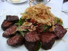 Cafe Pinot in #LA, 9 oz pan-seared prime hanger steak with sweet tempura onions, arugula, tatsoi, and frisee and herb salad