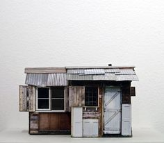 like the look of this - maybe it is a bit too much like a shanty town hut? but love all the different materials.